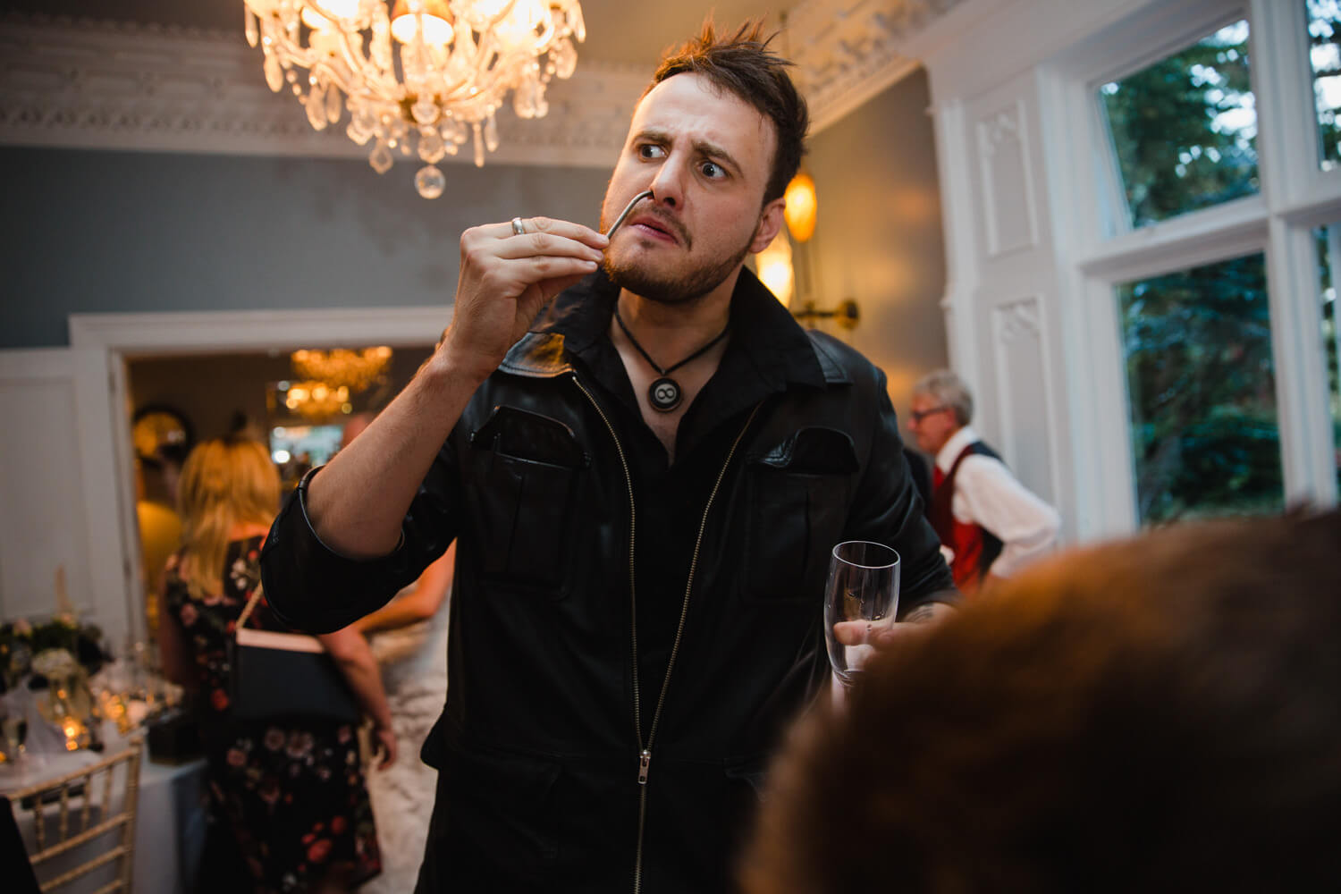 magician from infiniti magic wowed guests using skills with a glass and nail