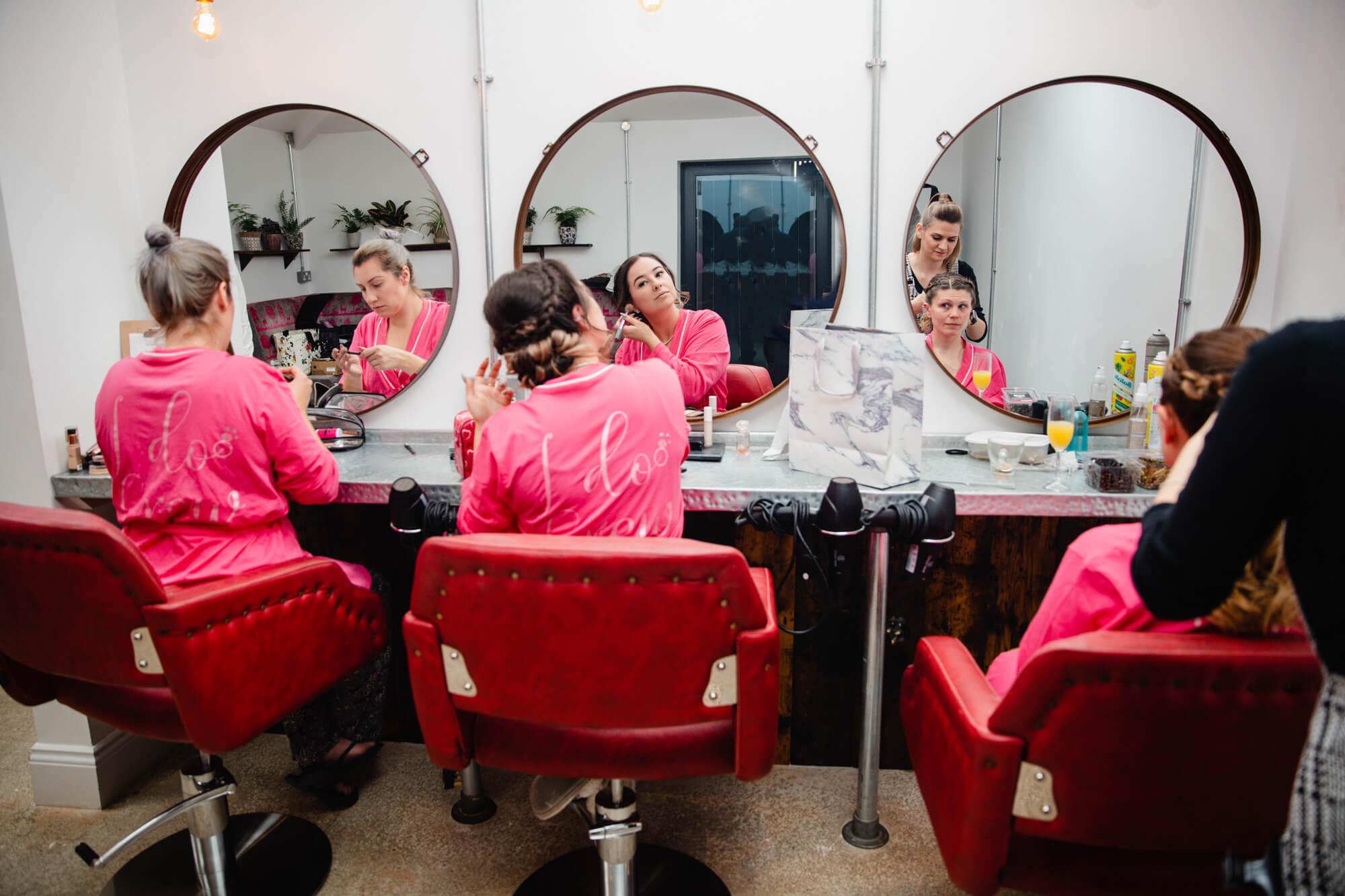 close up photograph of bridesmaids preparing make-up before wedding ceremony