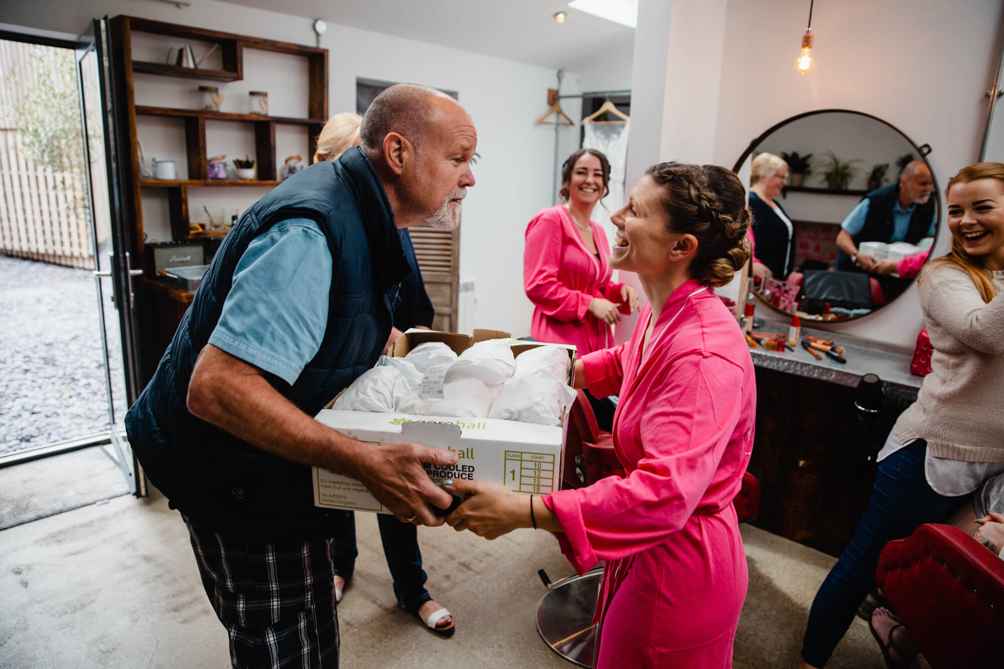 father of bridesmaid delivers sandwiches to bridal party before ceremony