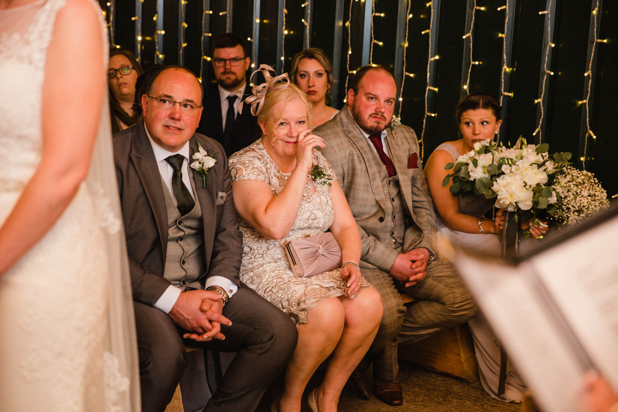 intimate moment as mother of bride wipes away a tear during wedding vows