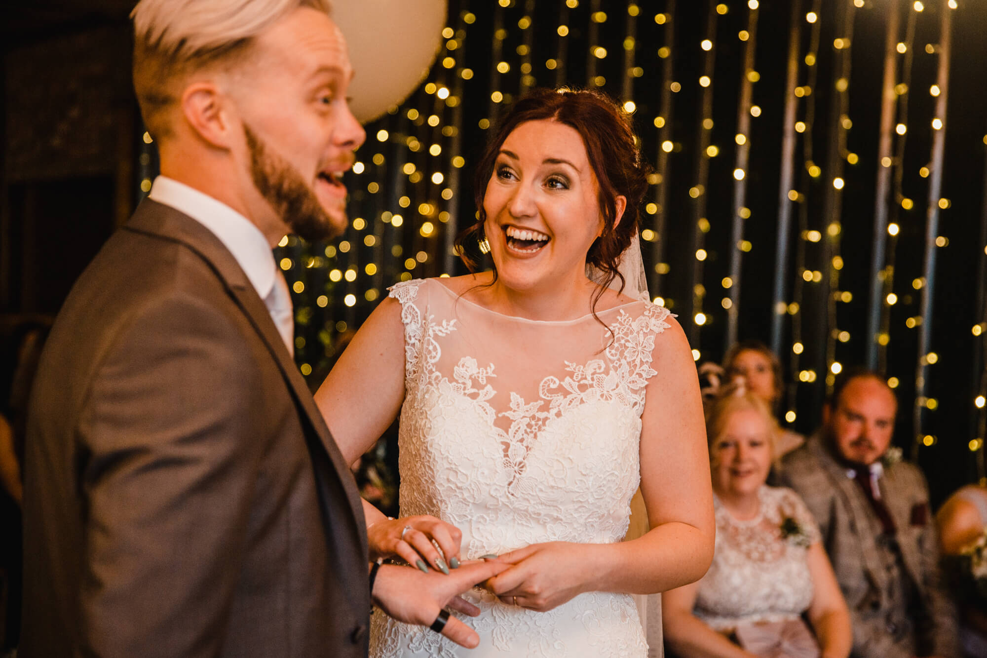 bride laughing at groom as during spoken vows