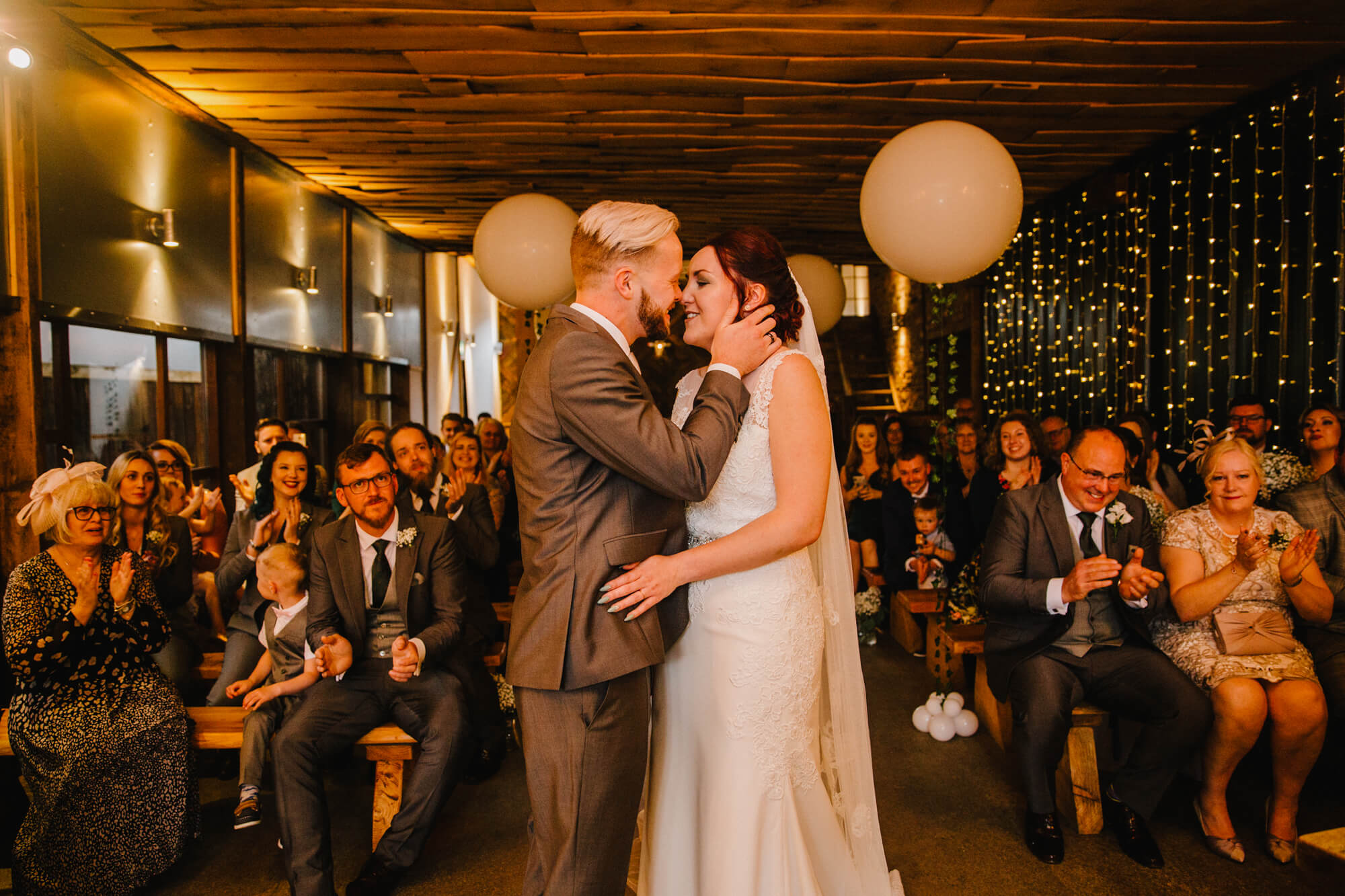 First kiss of newly wedded couple after service ends
