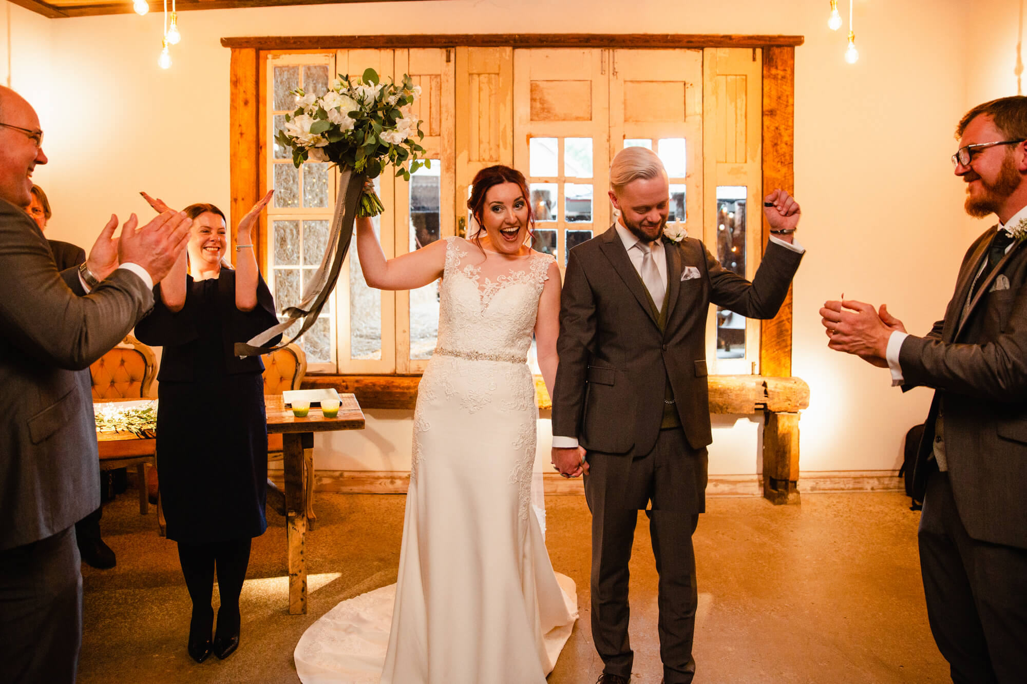 wedding processional begins at top of aisle as newly married couple celebrate with family and friends