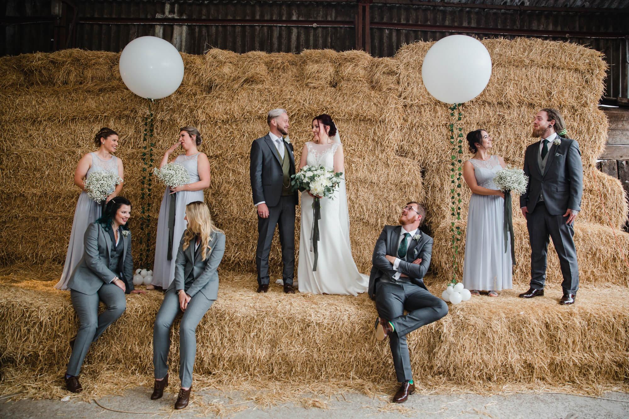 Owen House Wedding Barn photography group portrait on hay bale backdrop