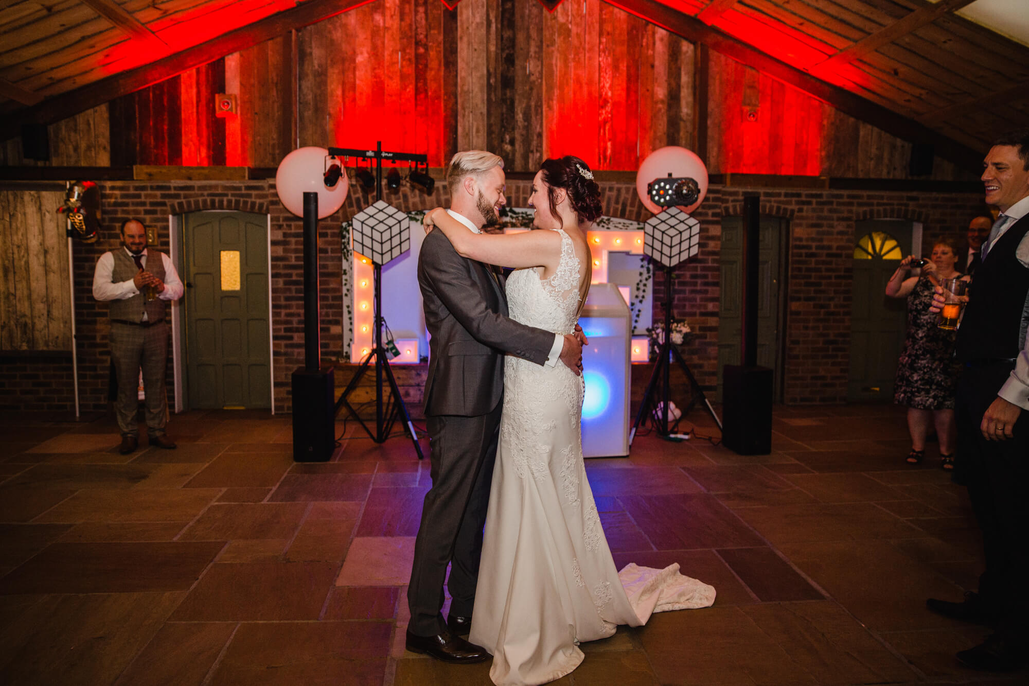 wide angle lens photograph of wedded couple on dance floor