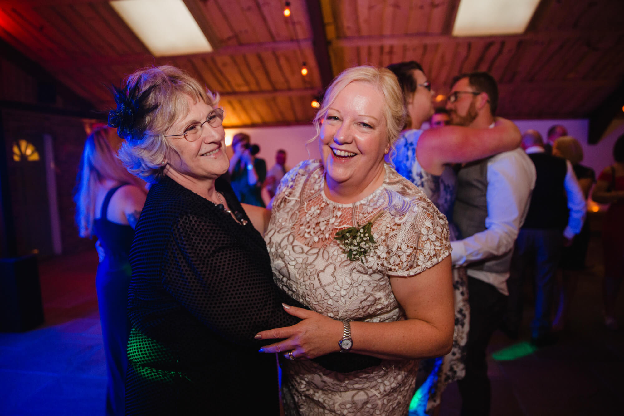 parents on dance floor dancing to music at end of wedding