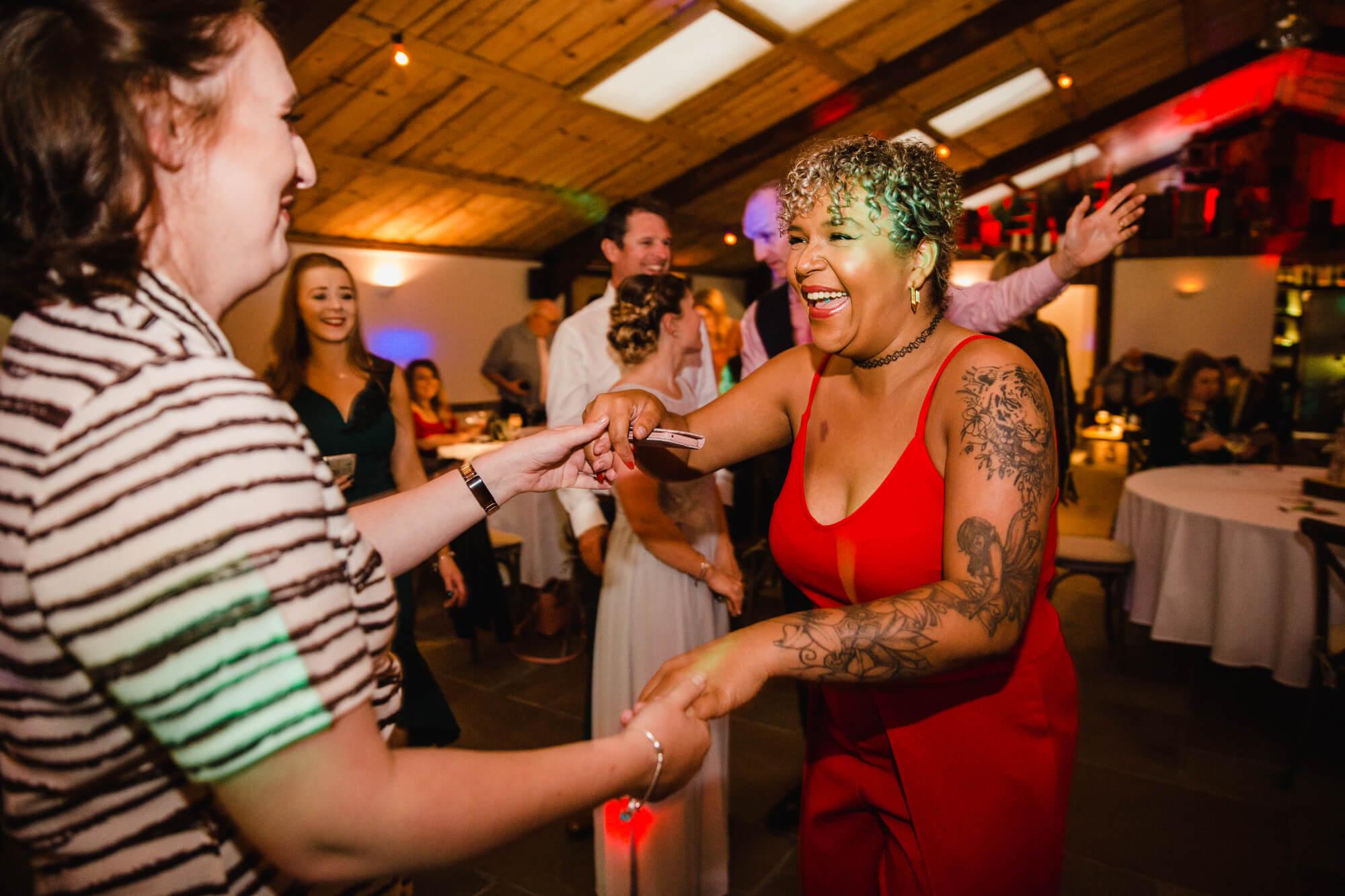 wedding guests dancing on dance floor and having fun