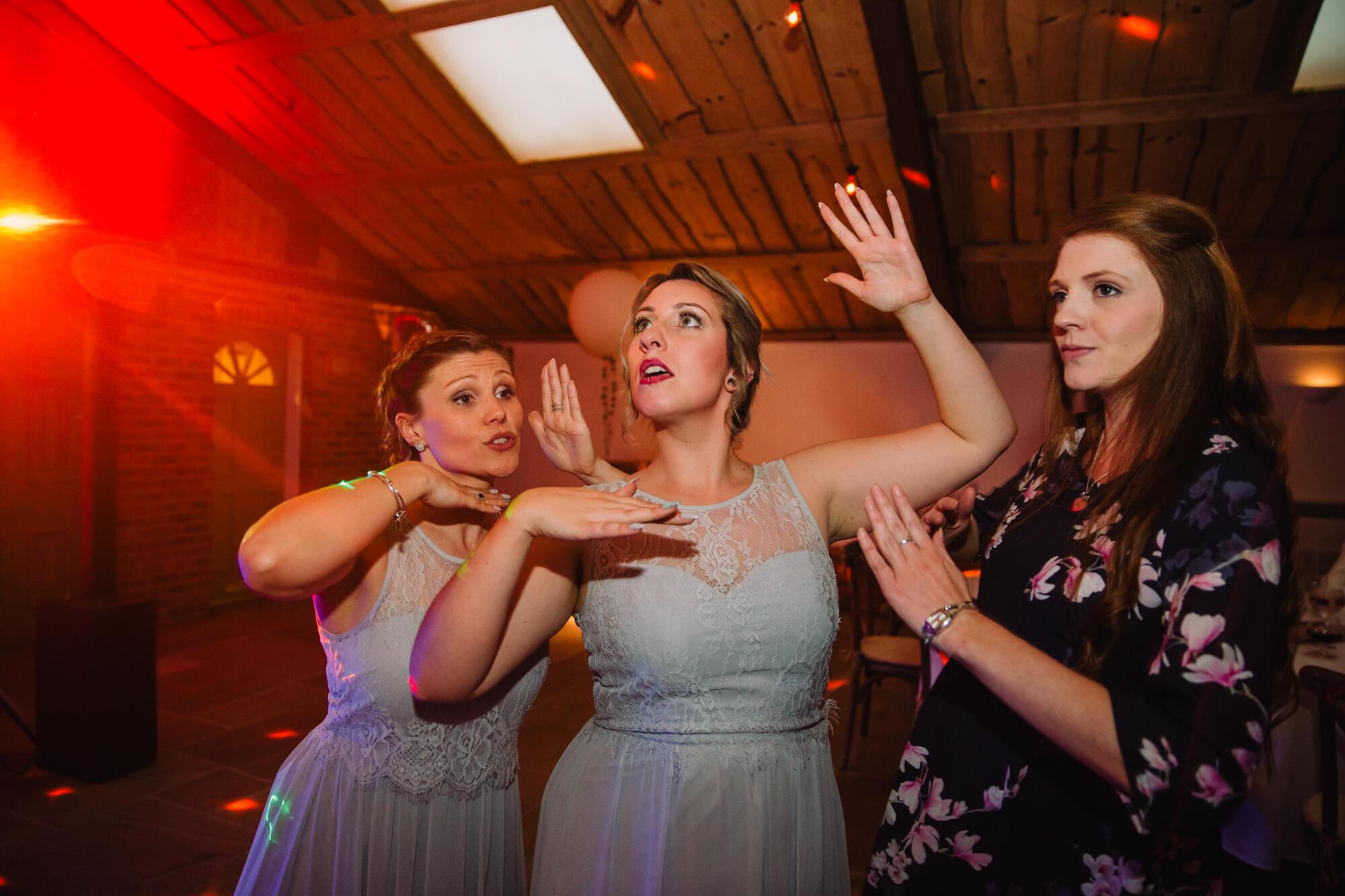bridesmaids posing and dancing to camera