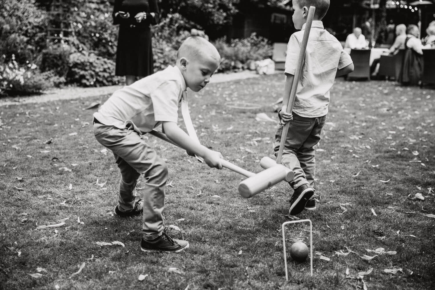 black and white photograph of children playing lawn games