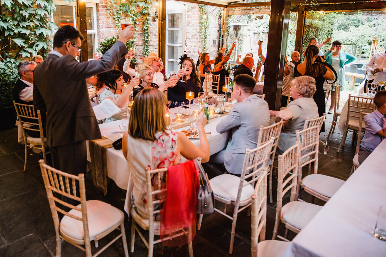 father of groom raises a toast to wedding party