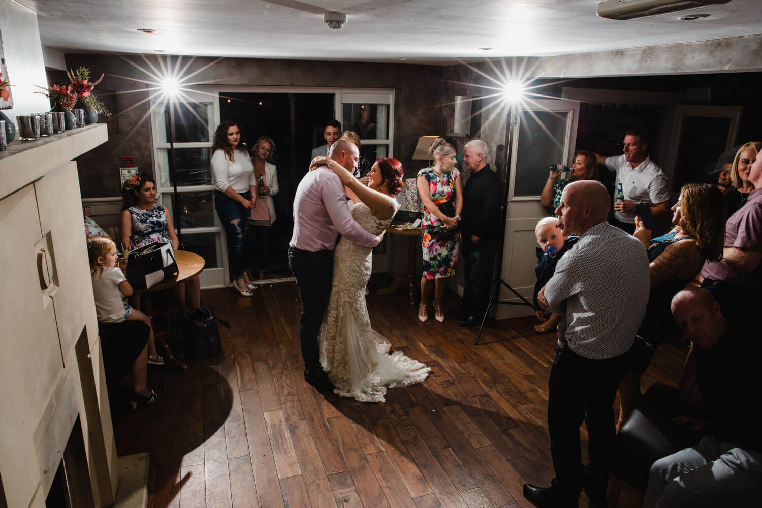 wide angle lens photograph of newly wedded couple first dance with off camera flash photography