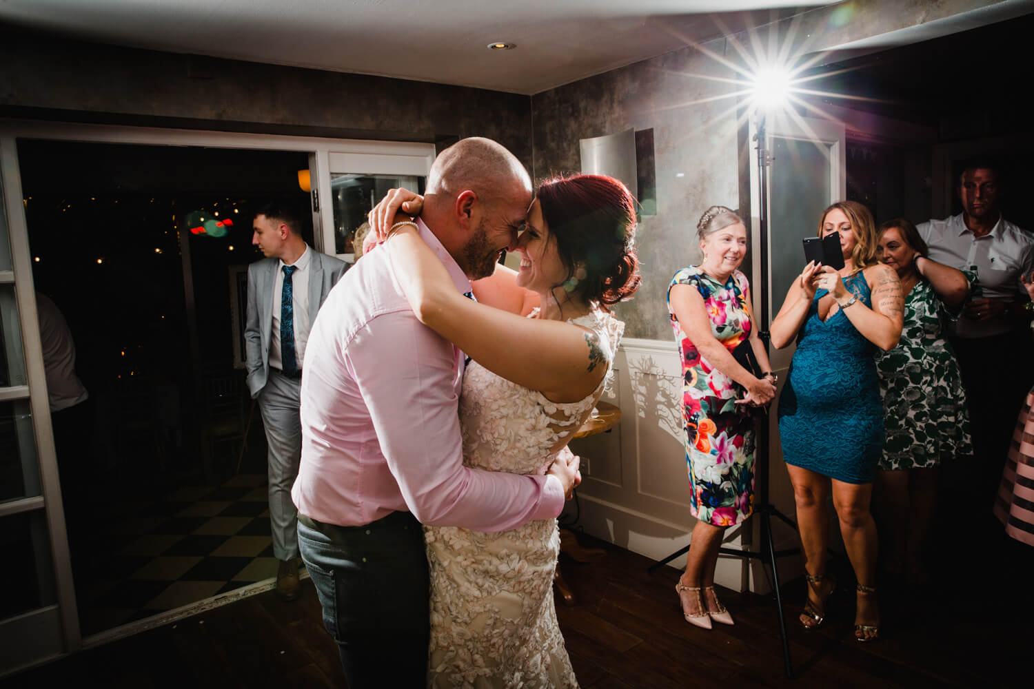 close up photograph of bride and groom together on dance floor