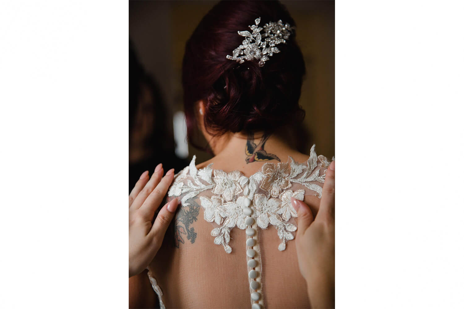portrait photograph of buttons fastened for wedding dress detail