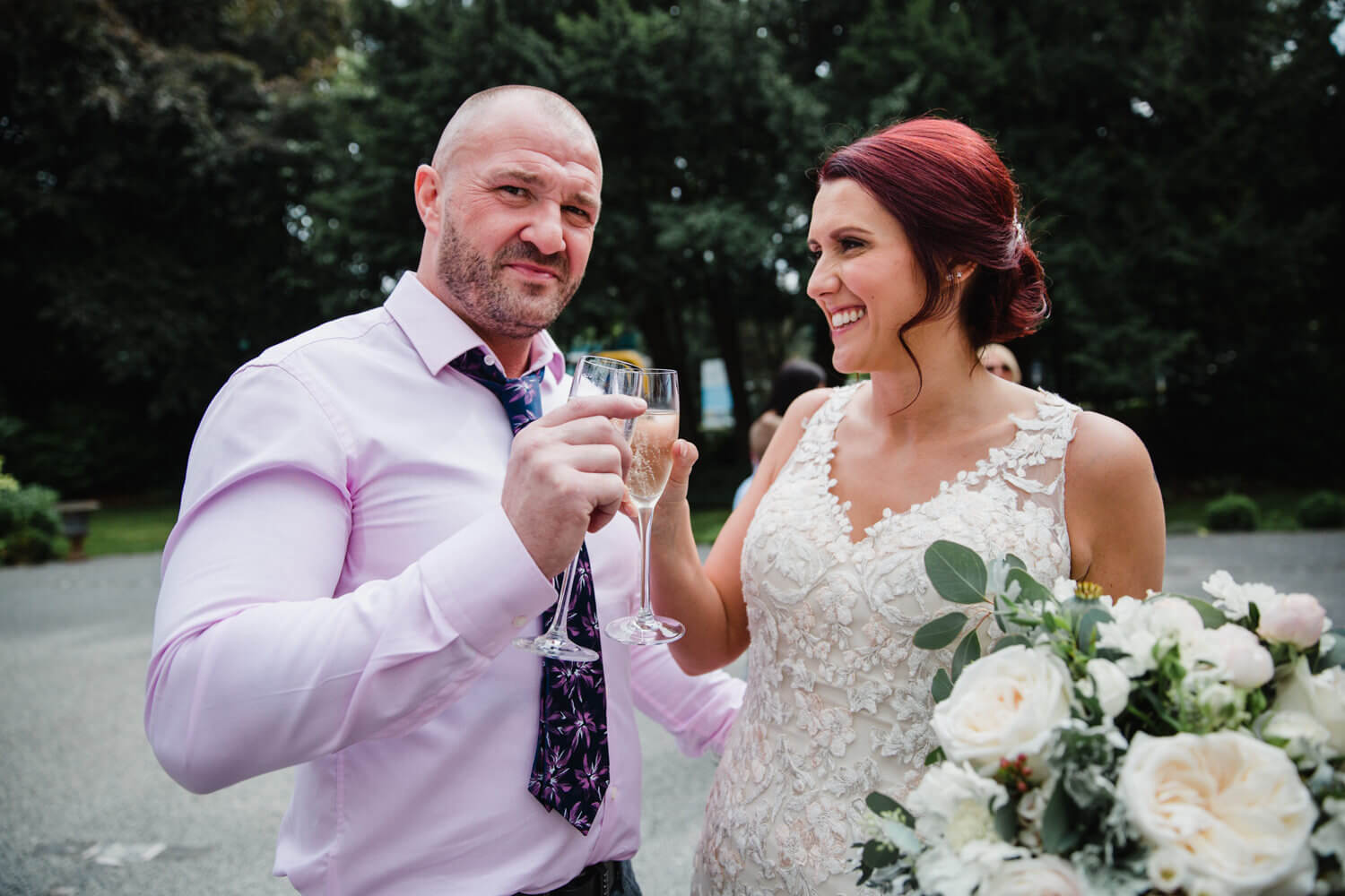 newlyweds clink champagne glasses in celebration of marriage