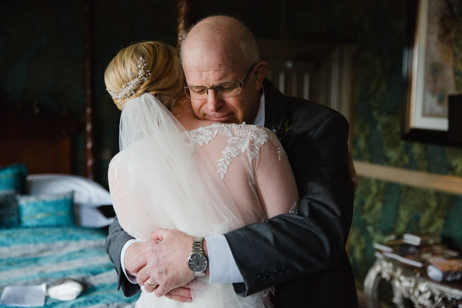Truly memorable moment when brides dad shared an intimate hug before the wedding ceremony