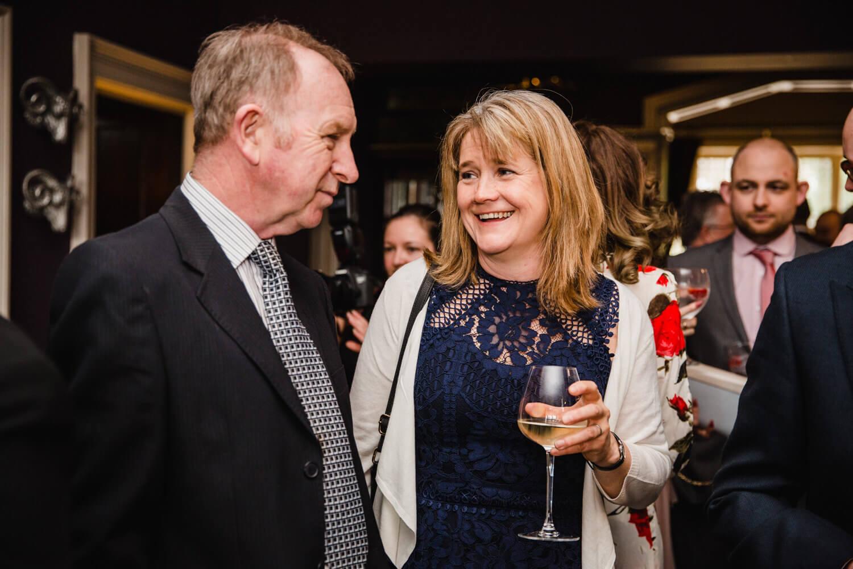 wedding guests having drinks before service begins