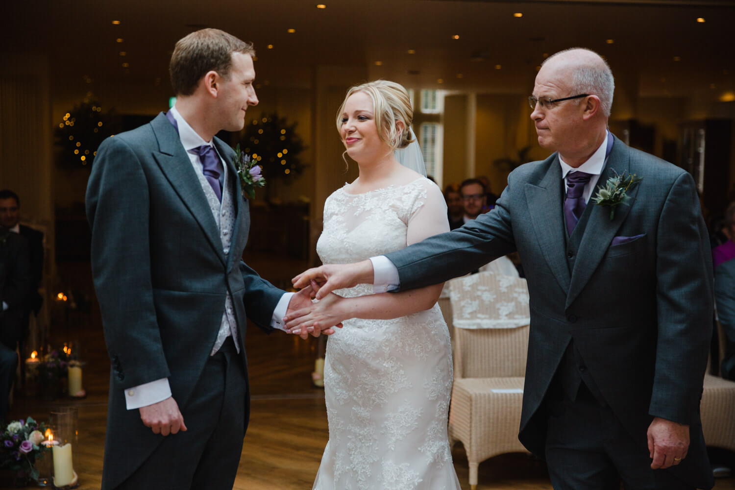 father giving bride away to groom at Mitton Hall