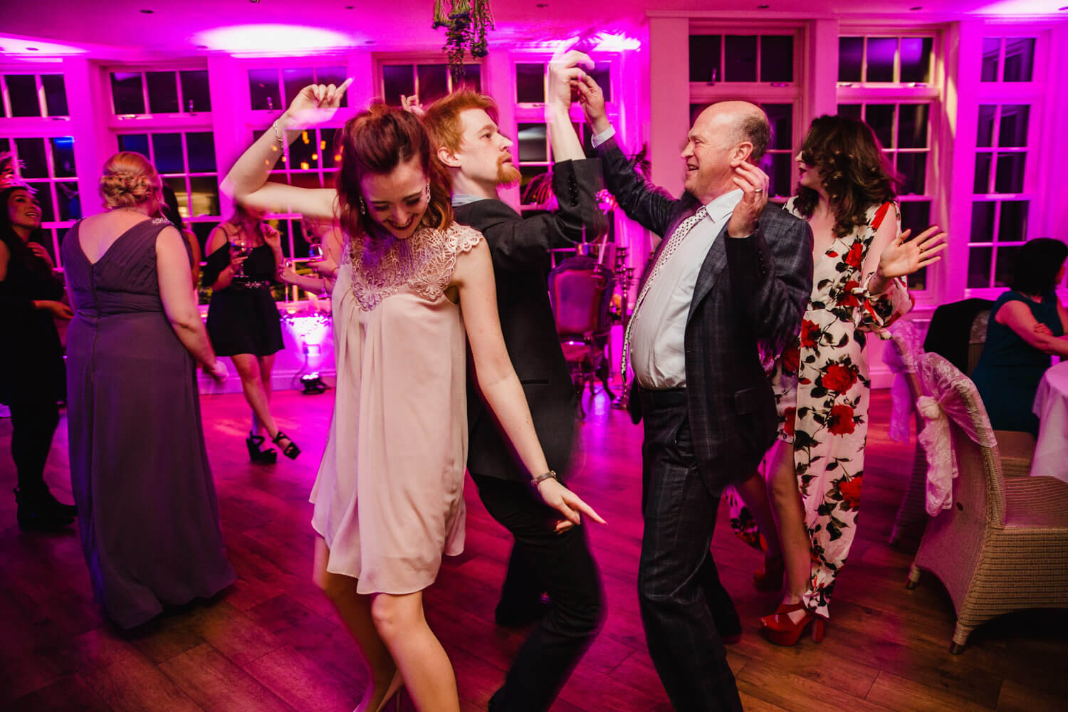 wedding guests party and dancing at Mitton Hall