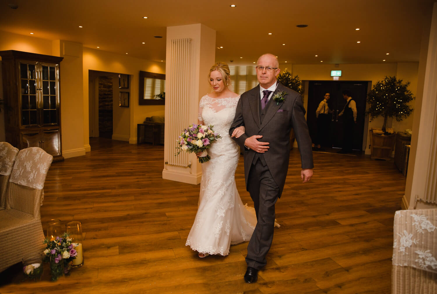 bride linking arms with father for wedding ceremony entrance processional