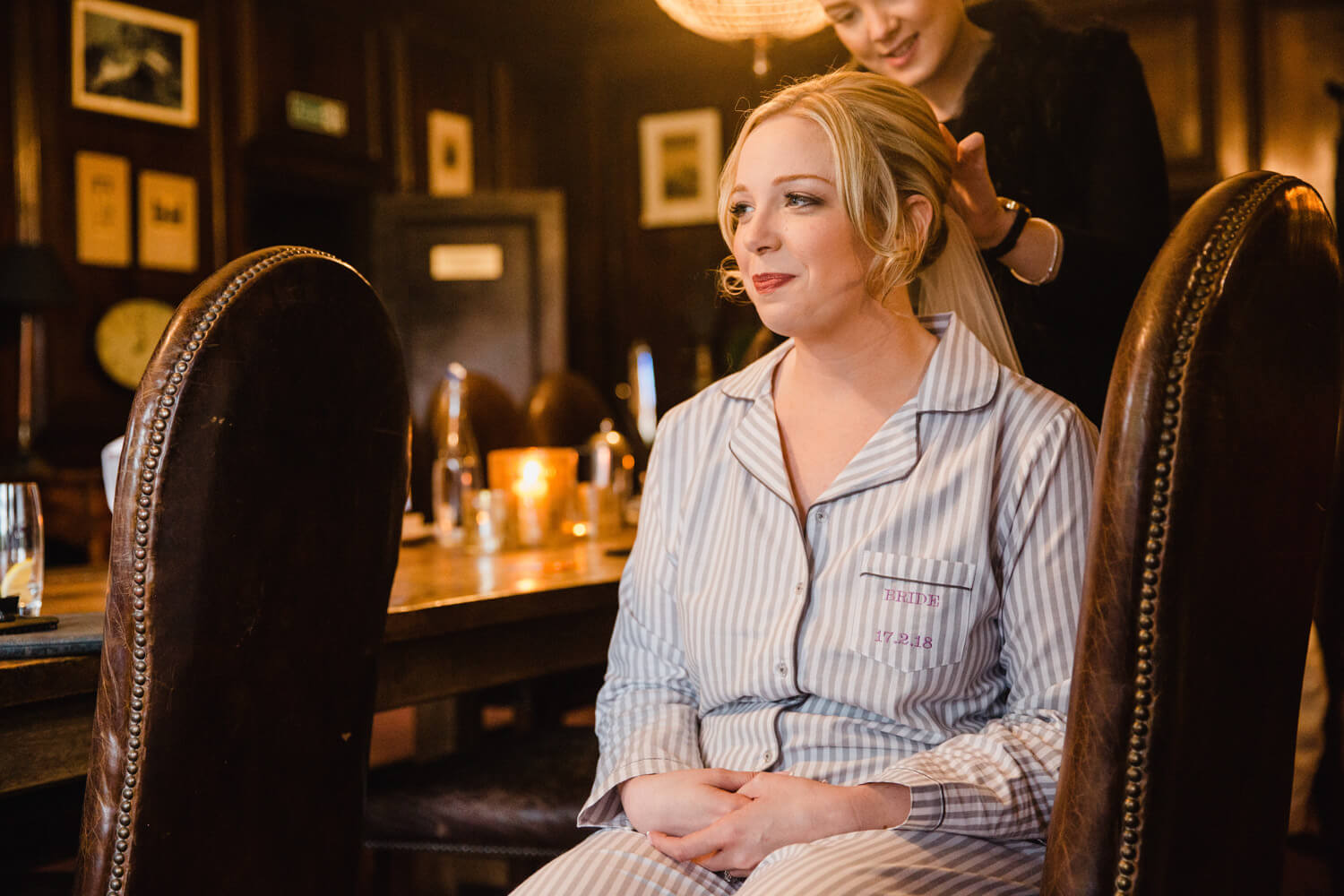 bride having hair styled in bridal suite of Mitton Hall