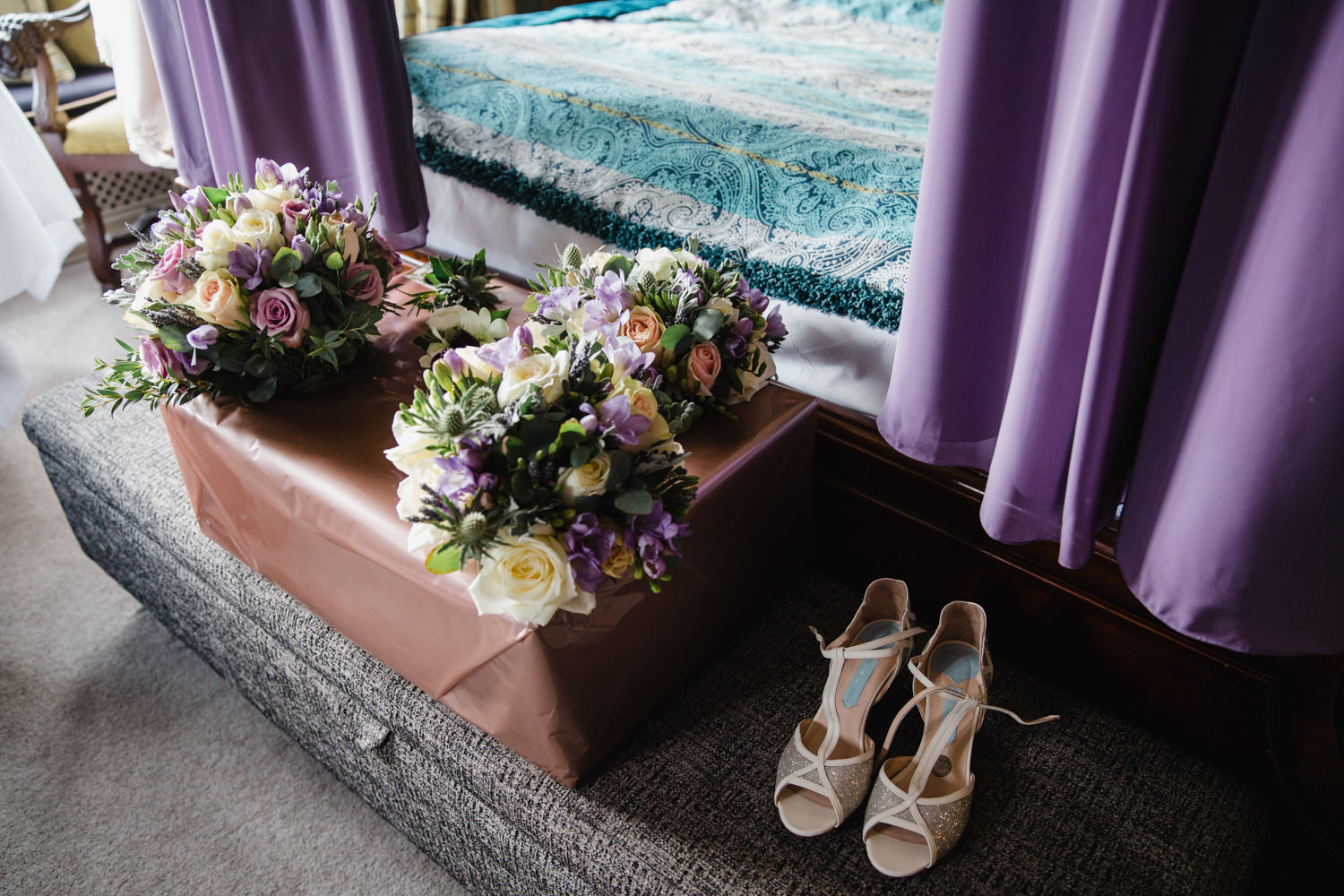 detail photograph of bridesmaid dresses bouquets and wedding shoes