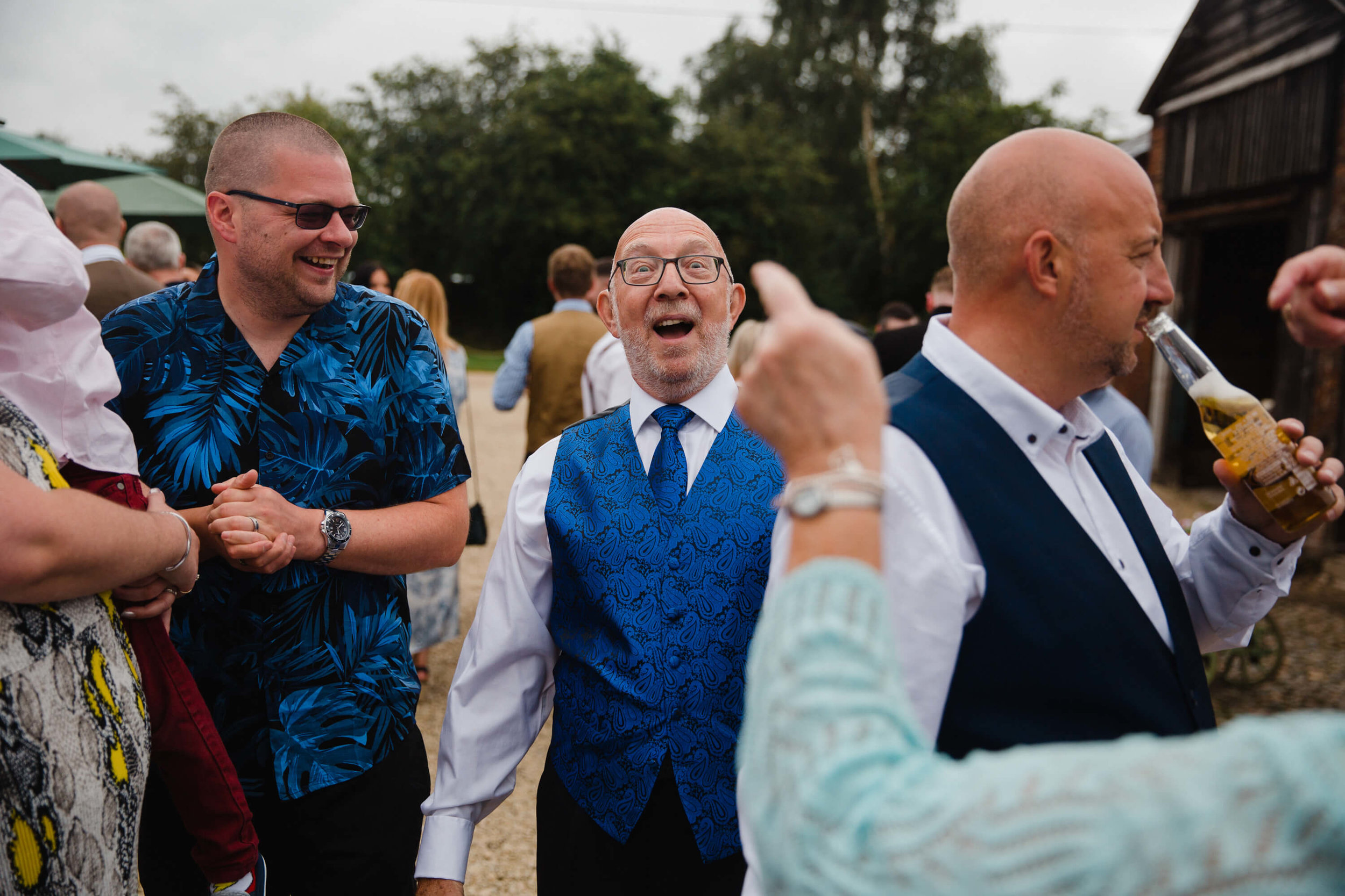 natural relaxed funny moment as wedding guest is pointed at