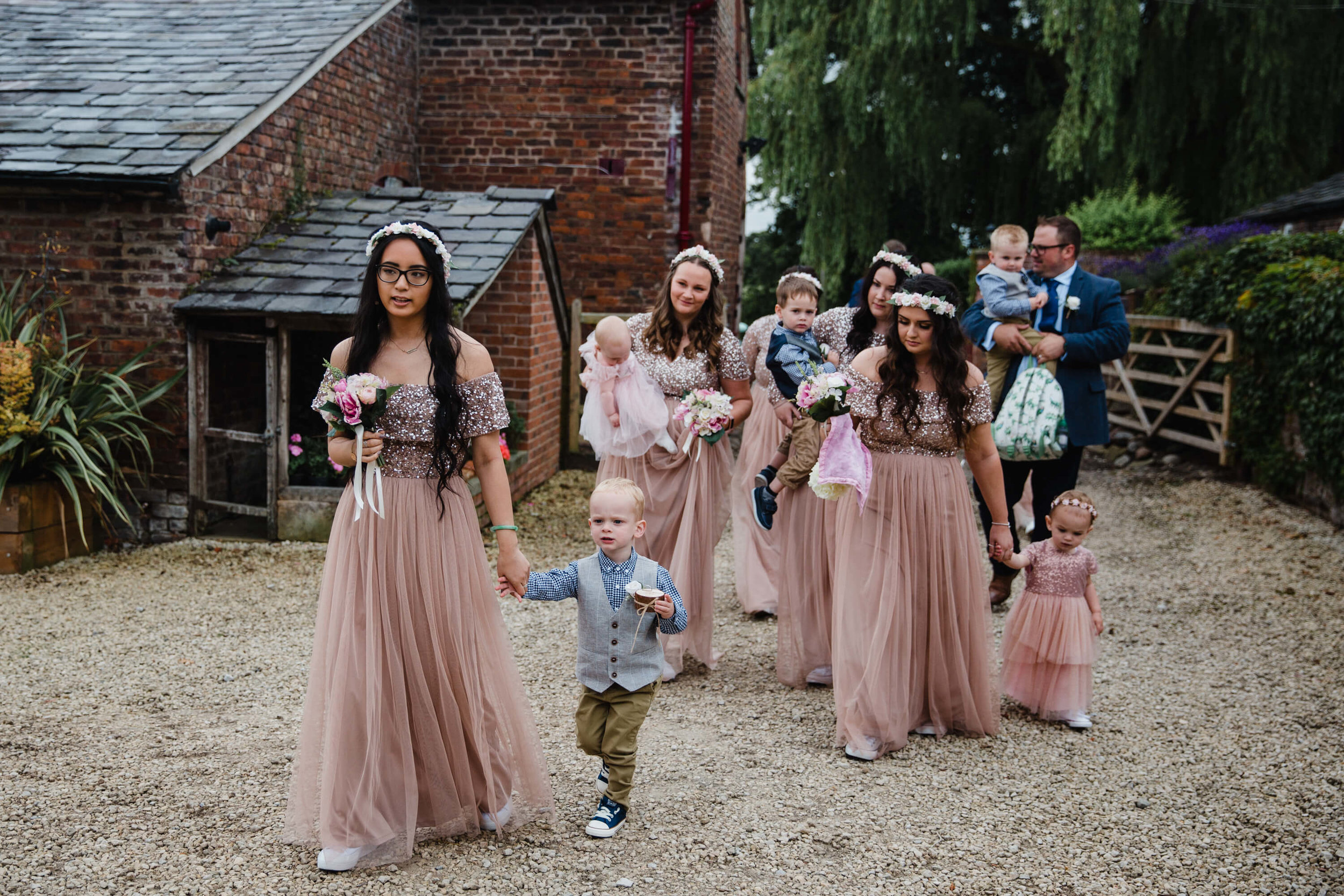 wedding procession of bridesmaids flock to service