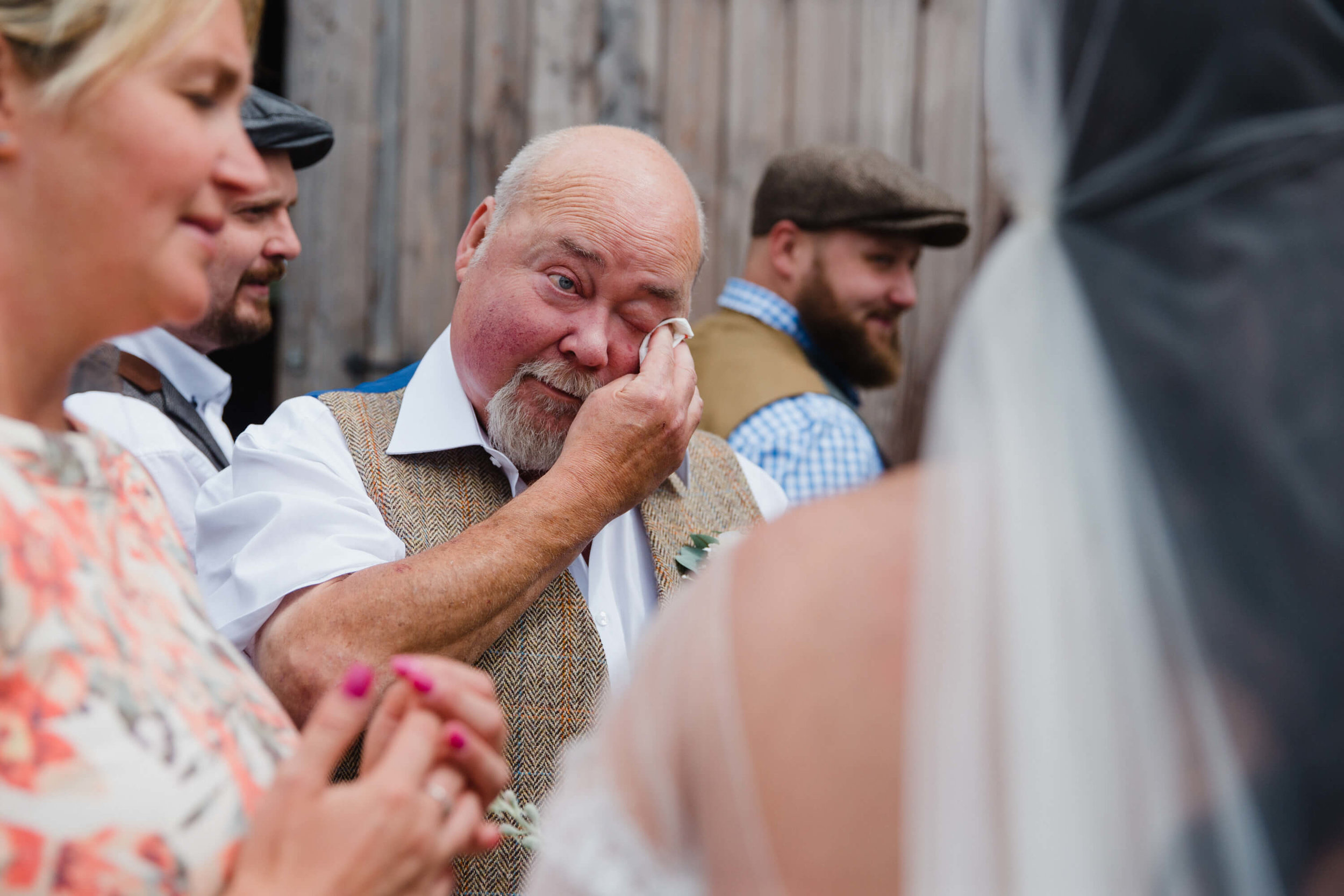 father of bride wipes away tear in natural moment caught on camera