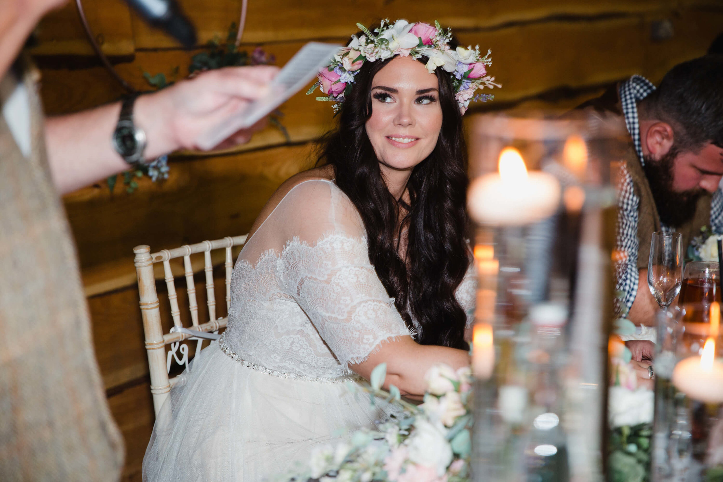 close up photograph of bride looking on at fathers speech