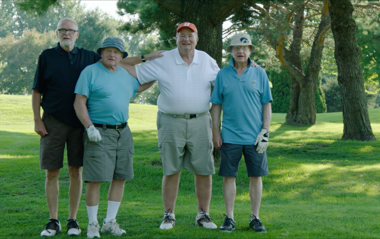 THE FOURSOME - Every July, four lifelong friends gather in a tiny Iowa suburb at the Waukon Golf & Country Club for the biggest tournament of the year. Far from the lush fairways of Augusta and oceanfront greens of Pebble Beach, the Waukon Club, founded less than one hundred years ago, is a small, simple affair. But the intimate course, with just under two hundred members, produced one thing the larger clubs never could - a friendship that began on the first hole and lasted well beyond a round of 18…