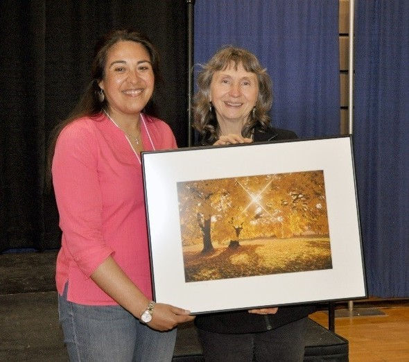 Pictured: Heather Medina Sauceda, NRCS basin team leader for the Central Coast Upper Willamette and Southwest Basins, presents Teresa Matteson, soil health coordinator with the Benton SWCD, with the 2016 District Employee Partnership Award at the CONNECT conference in Pendleton, Oregon, May 2, 2017.