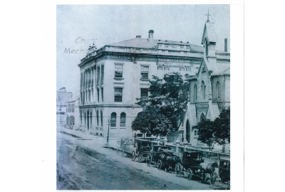 School House. Built in 1855 and demolished in 1909 to make way for the new Parish House. Architect: Frederick Cumberland. Located on Church Street, SE corner of Adelaide Street. Taxi stands in front. City law was that all horses must face the lake.
