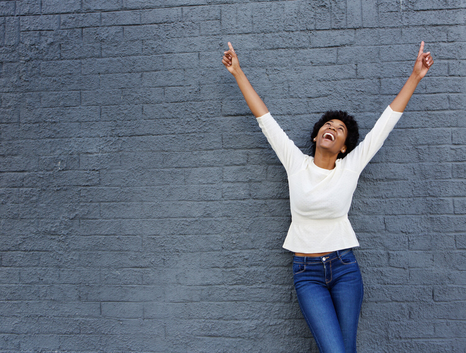happy woman pointing to the sky .jpg