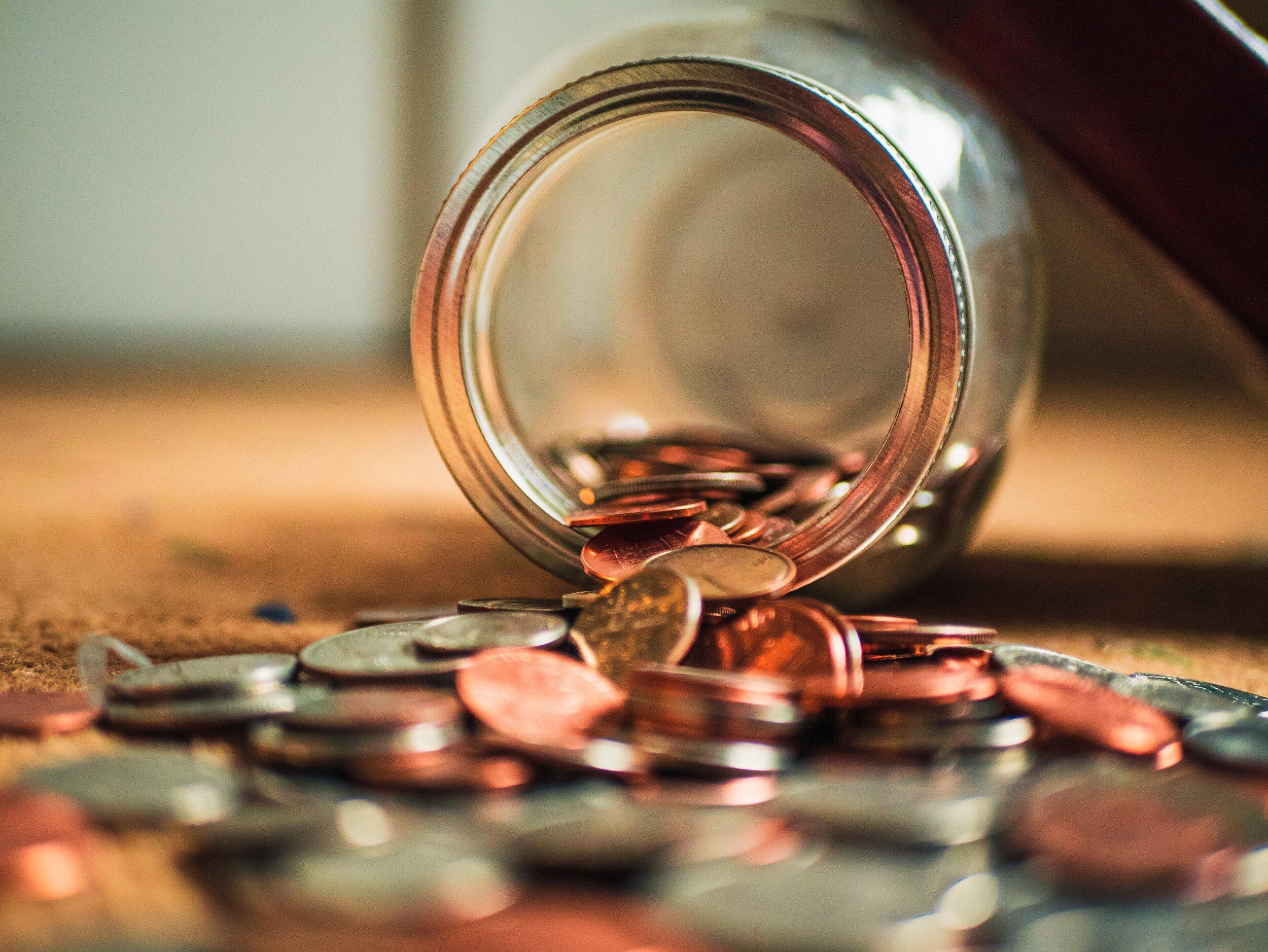 Money falling out of jar.jpg