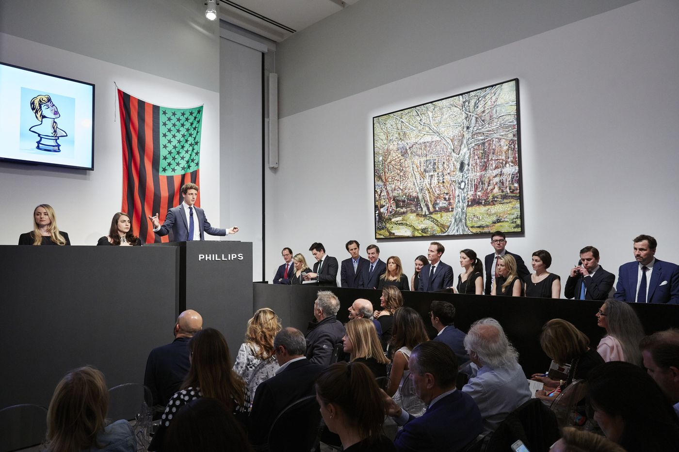 Auctioneer Henry Highley presides over the Evening Sale in New York when Peter Doig's 1991 masterpiece broke auction records.