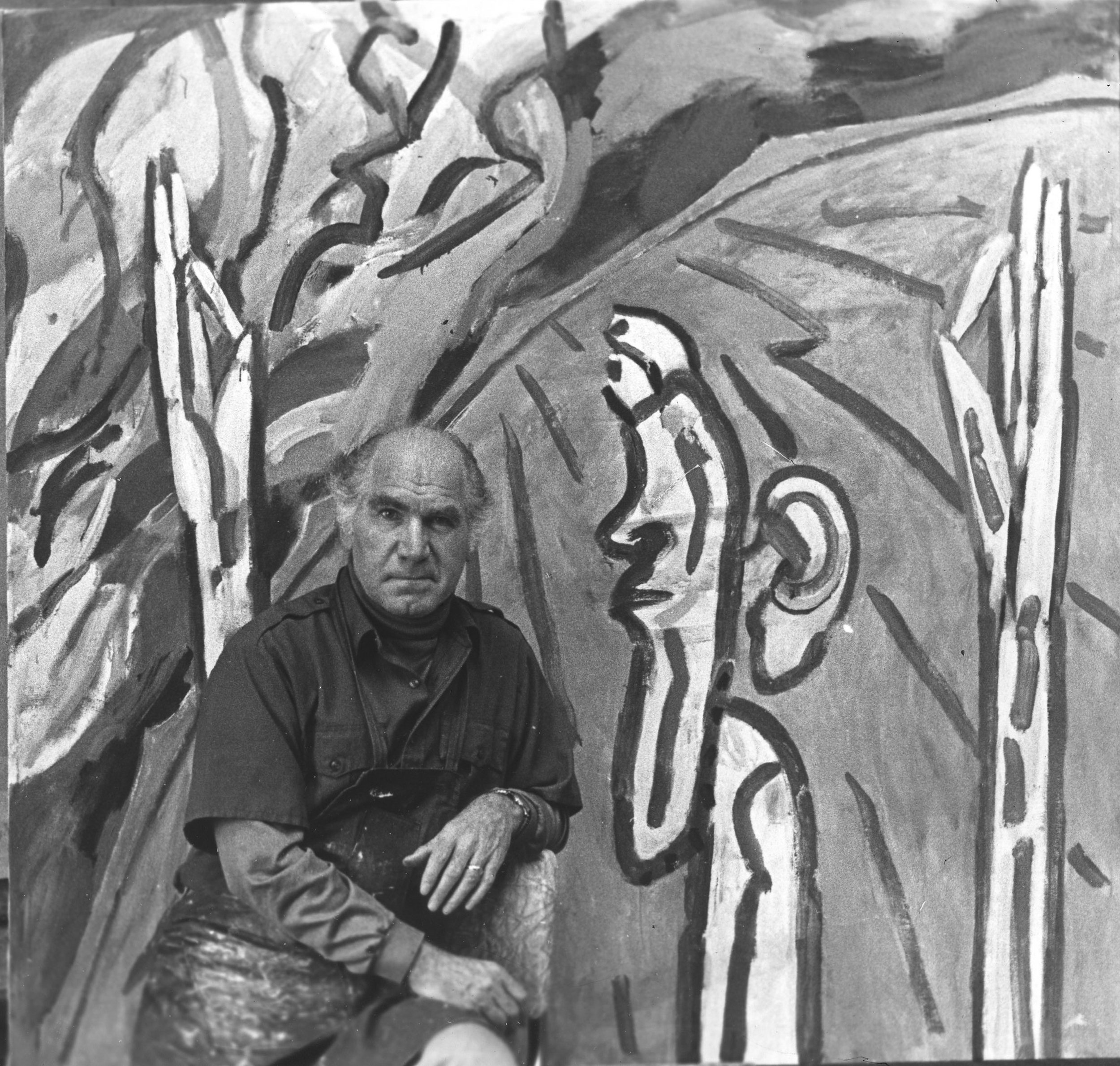 Irving Kriesberg in his studio in front of the painting  Learning  (1981).