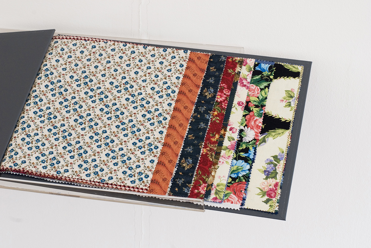 Faulty Samples I , 2012 - 2014 Bound book of works on found fabric samples 48 x 32 cm / 18.9 x 12.6 inches (closed book)
