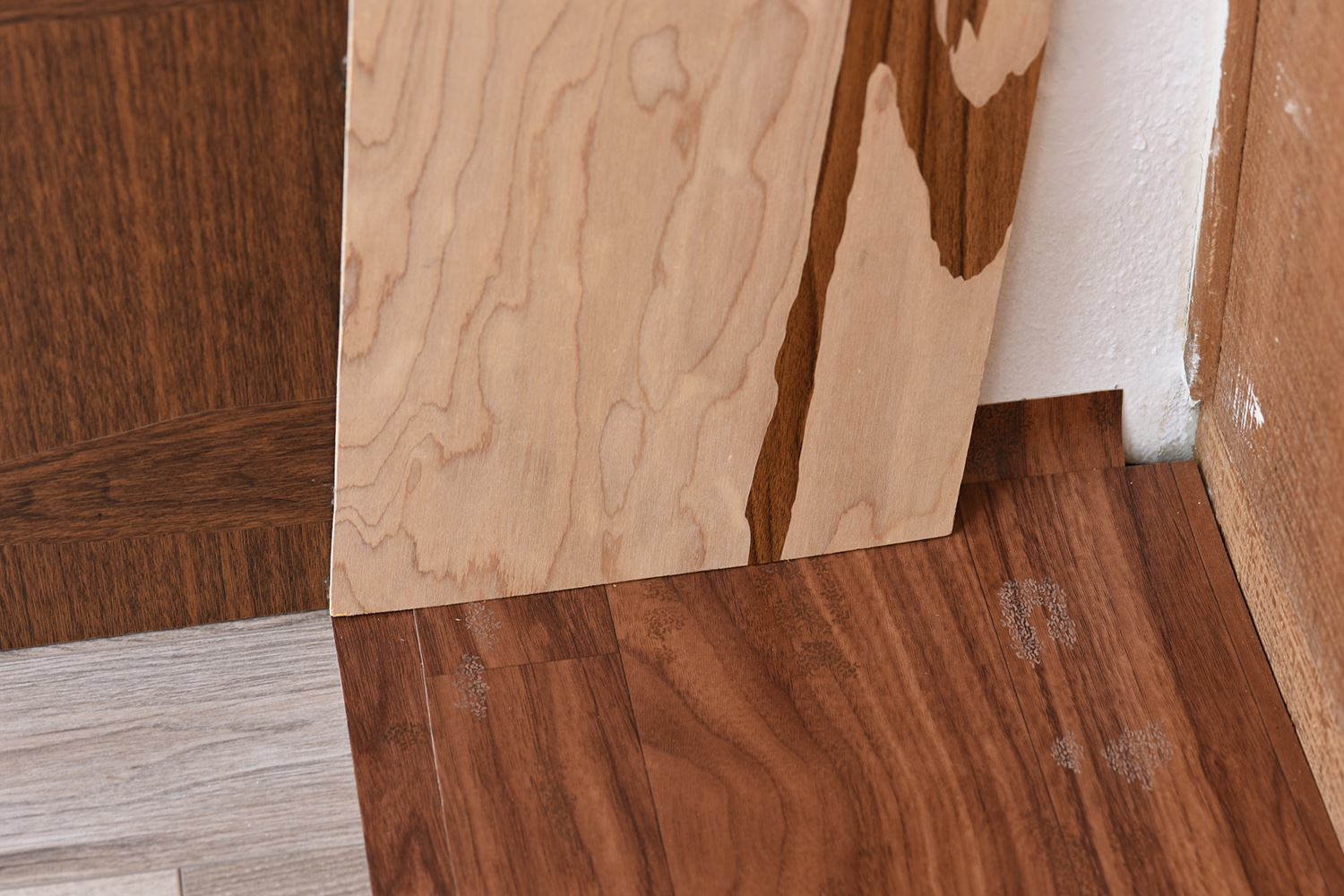 Masquetry V  (detail), 2014–2018 Adhesive vinyl on found laminate and wood   Stain Paintings , 2018 Acrylic on found vinyl flooring