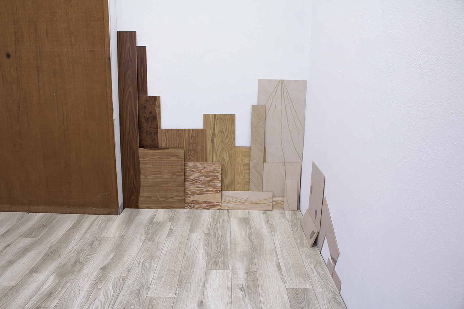 Masquetry V  (detail), 2014–2018 Adhesive vinyl on found laminate and wood Dimensions variable