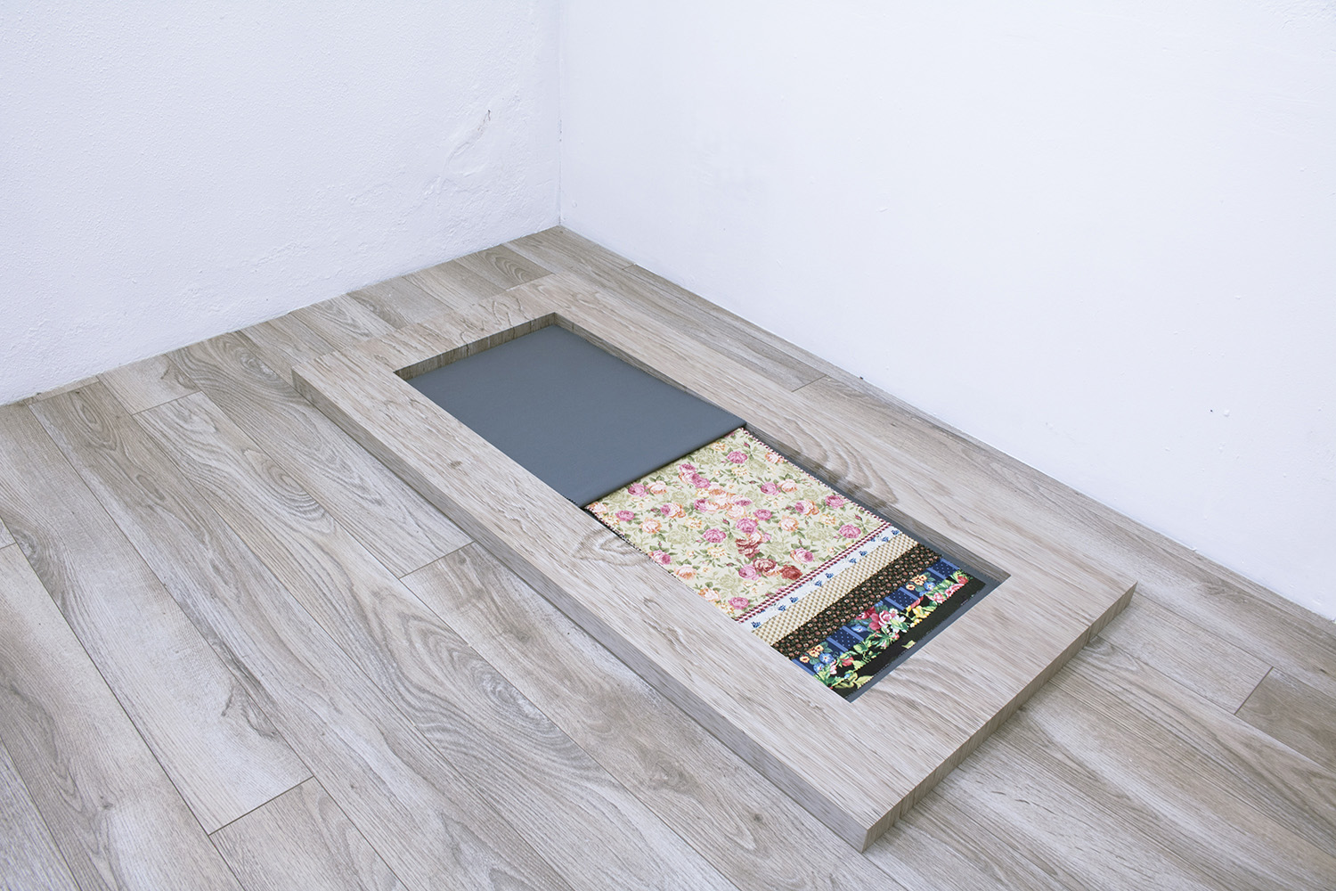 Floor Paintings , 2018 Acrylic on MDF on floor   Faulty Samples IV , 2014–2018 Fabric collages and acrylic on found fabric in bound book