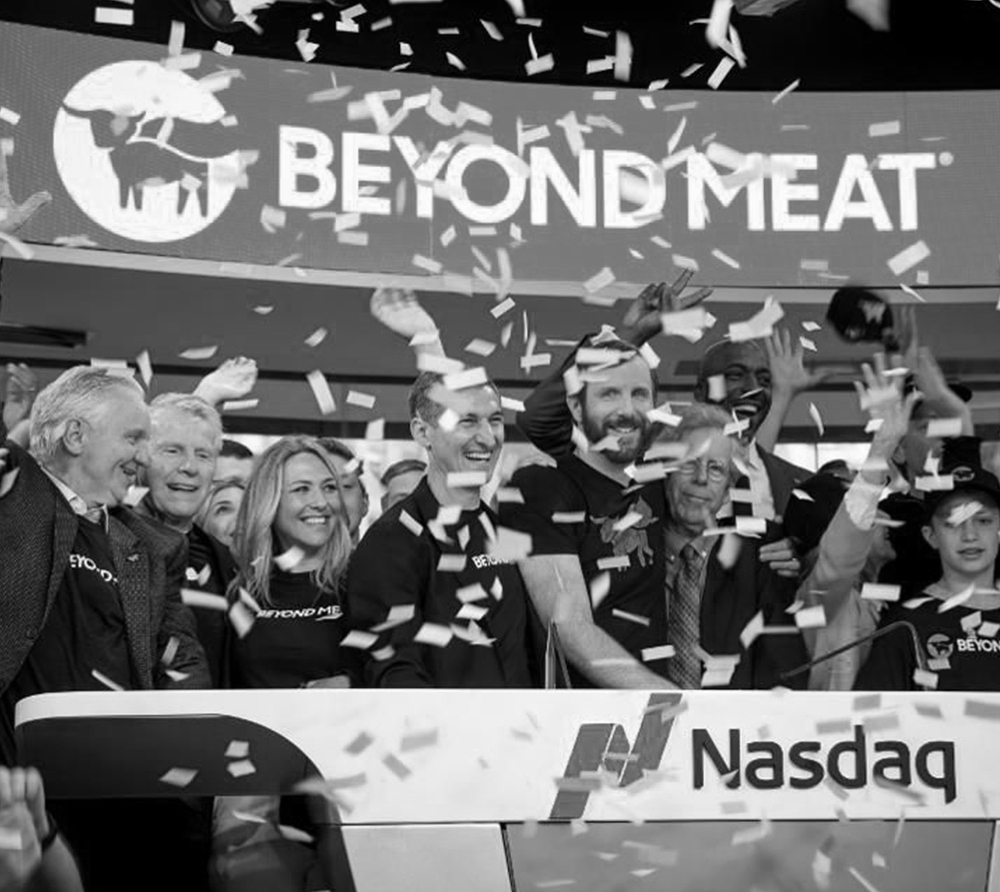 """Beyond Meat Goes Public with a Bang - Beyond Meat, a portfolio of revolutionary plant-based meats, went public on the NASDAQ Stock Exchange under the ticker symbol """"BYND"""" in May 2019. The Company's stock had the biggest first day pop of any IPO since before the 2008 recession. It more than doubled after the company priced its IPO at the high end of a range that it had already boosted. Beyond Meat was founded by vegan Ethan Brown in 2009, and its Beyond Burger is sold at Whole Foods and restaurant chain TGIF, among others."""