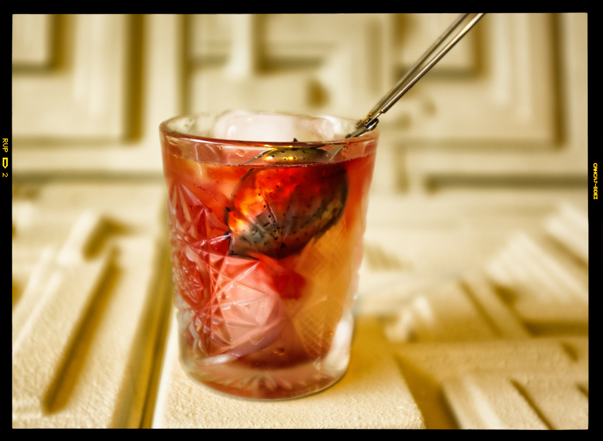 """The Bleeding Edge. A clarified milk punch Long Island iced tea-inspired drink, with hibiscus infusion that """"bleeds."""" Tequila, vodka, Rum, gin, triple sec, lemon, cola."""