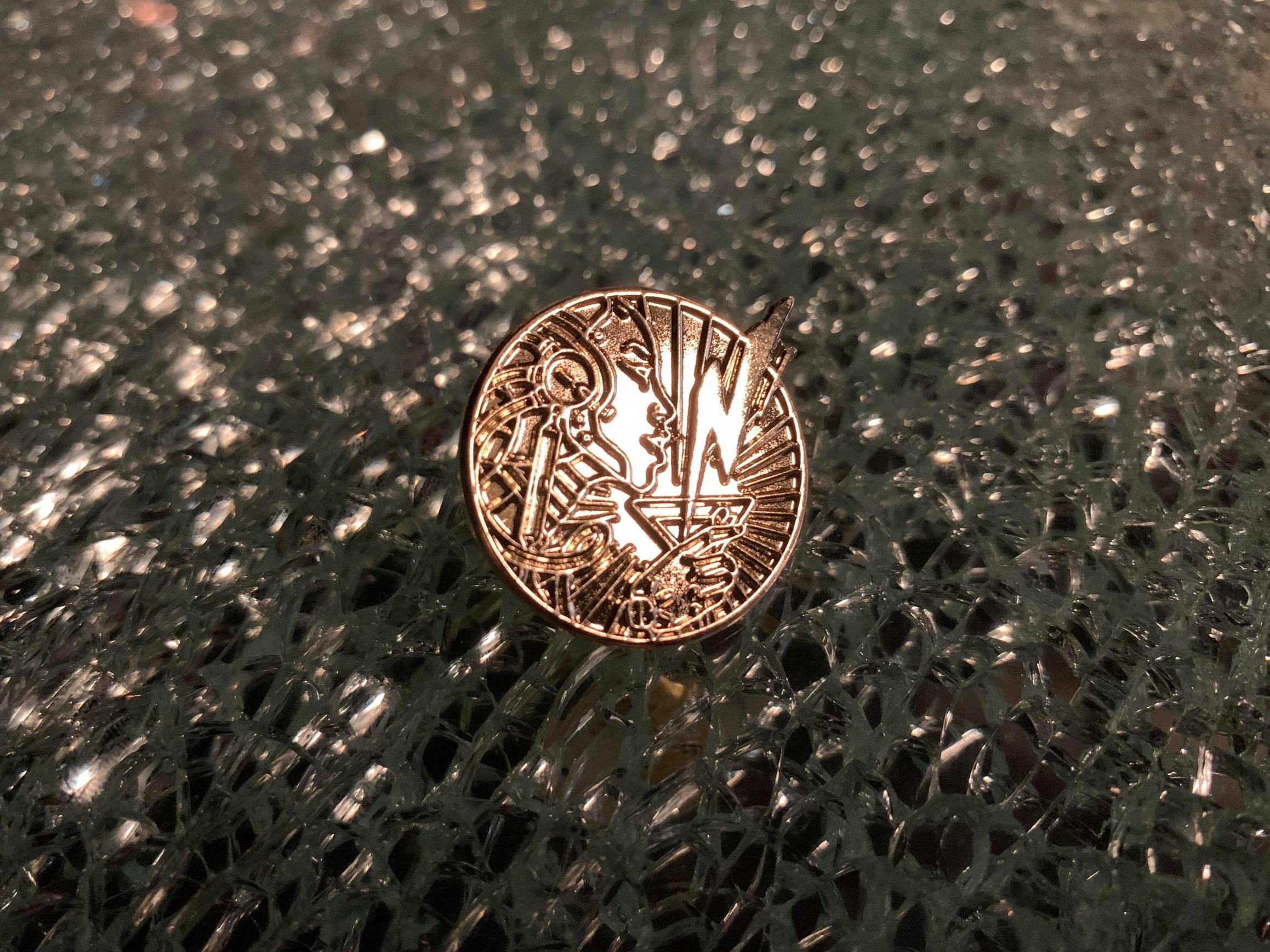 Brass lapel pin - $8