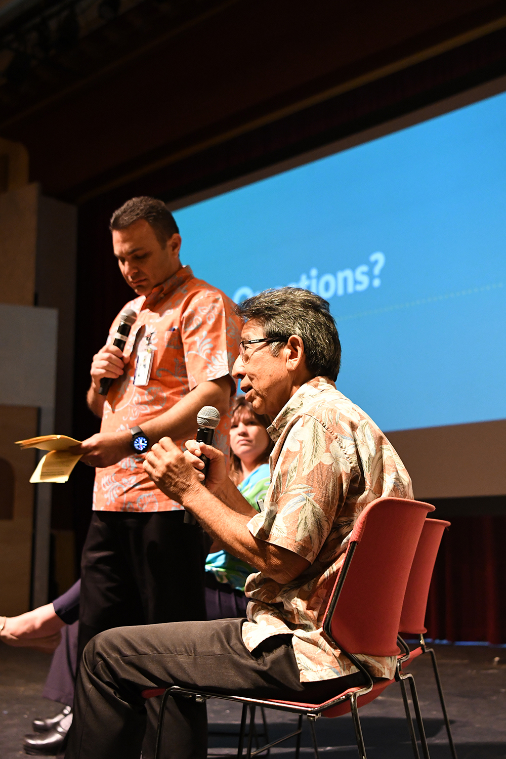 Brian Ige, construction manager for the Wailuku Town Improvement Projects, answers questions during Thursday night's meeting alongside Maui County Managing Director Sandy Baz and Project Administrator Erin Wade inside Iao Theater.