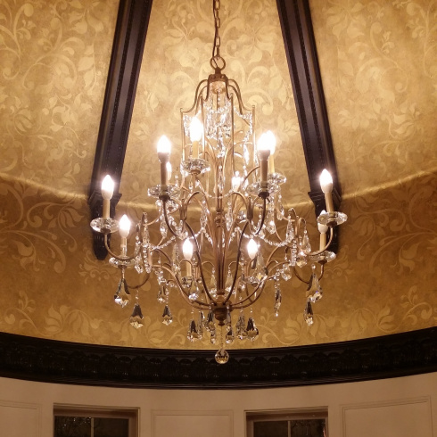 The Crystal chandelier hanging from the ceiling