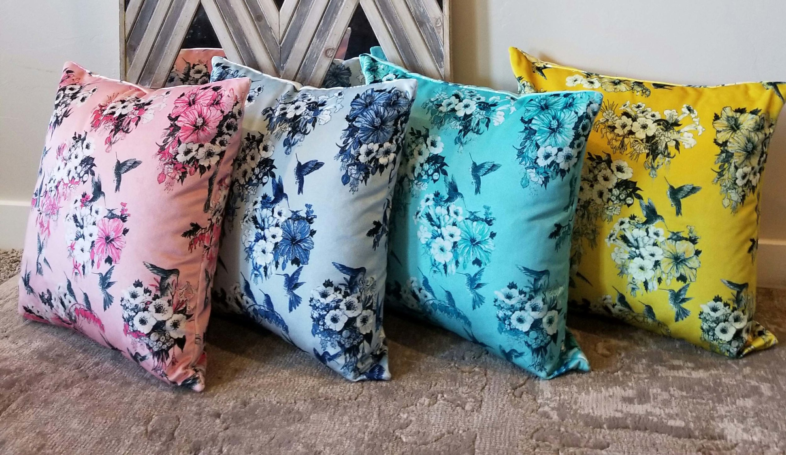 Set of colored floral printed fabric pillows