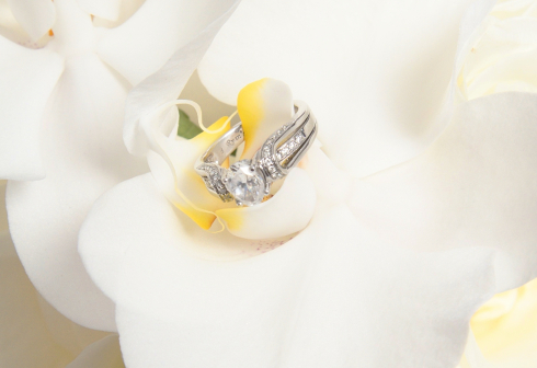 Engagement ring on the white moth orchids