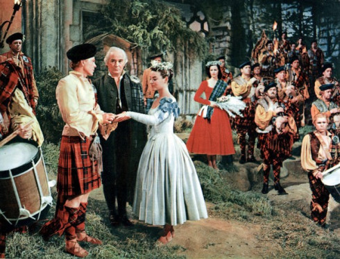 A movie scene from brigadoon with a bride wearing blue wedding dress