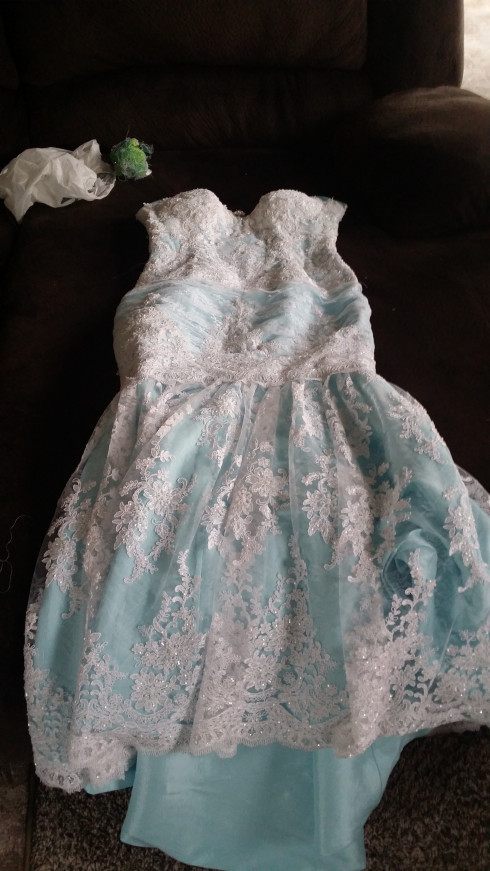 Blue wedding dress covered with white lace