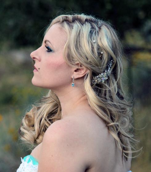 Azure Elizabeth wearing her aquamarine earring